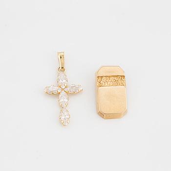 BERLOCKER, 2 st, en med vita stenar i form av ett kors, en helt i guld.