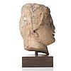 A marble head of a woman, probably roman 100-200 ad.