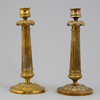 A pair of Empire bronze candlesticks, 19th century.