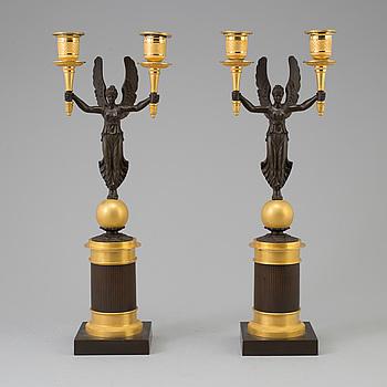 EMPIRE, A pair of Empire bronze candelabra, first half 19th century.