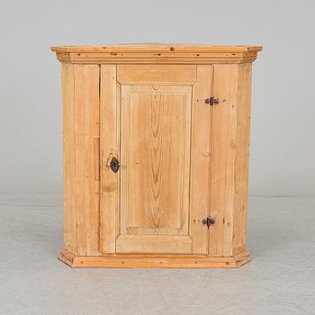 A 19th century corner cabinet.