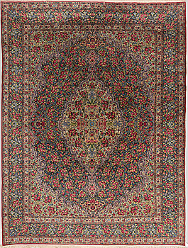 A semi-antique Kerman, around 351 x 269 cm.