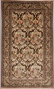 A silk Qum rug, around 220 x 134 cm.