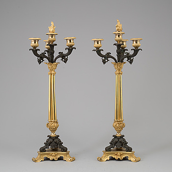 EMPIRE, A pair of late Empire gilt bronze candelabra, mid 19th Century.