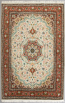 A carpet from Tabriz, part silk, ca 289 x 200 cm.