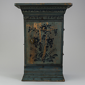 a oainted swedish wood wall cabinet, dated 1807.