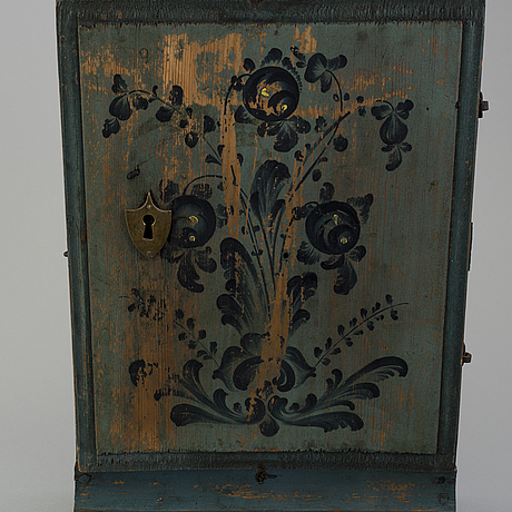 A oainted swedish wood wall cabinet, dated 1807