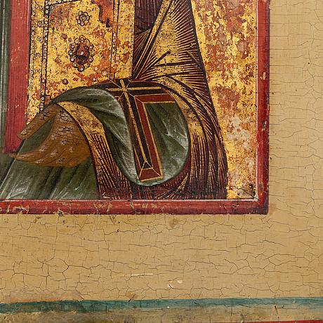 A russian icon, tempera on panel, 18th century.