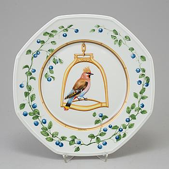 """a set of 12 porcelain plates """"L'etrier Perchoir"""" by Hermès."""
