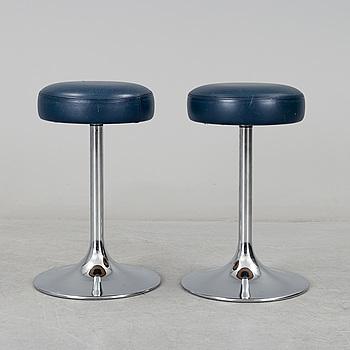 A pair of chromed metal stools by Johanson Design, Markaryd, Sweden.