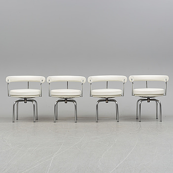 """A set of four """"LC7"""" chair by Charlotte Perriand, in collaboration with Le Corbusier, Cassina, Italy."""