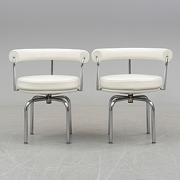 """A pair of """"LC7"""" chairs by Charlotte Perriand, in collaboration with Le Corbusier, Cassina, Italy."""