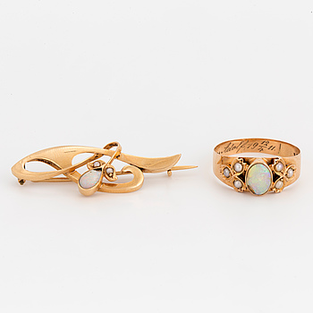 An 18K gold brooch and ring set with cabochon-cut opals and seed pearls.