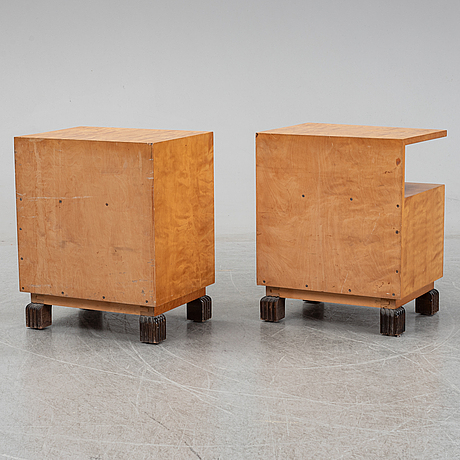 A pair of bedside tables with bed frame.