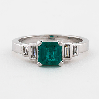 A emerald and baguette cut diamond ring.