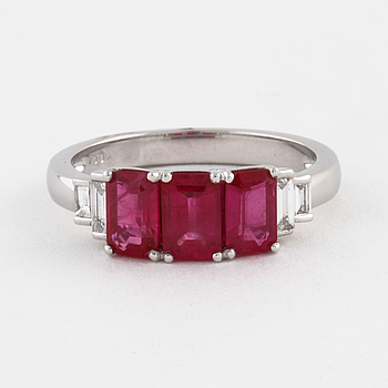 A ruby and a baguette cut diamond ring.