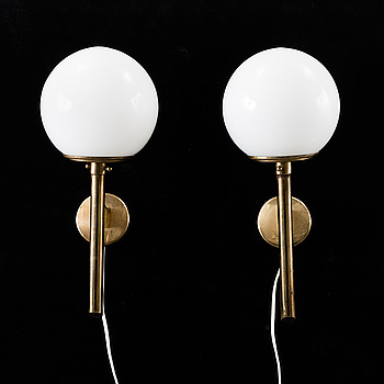 A pair of 20th century brass and glass wall lights.