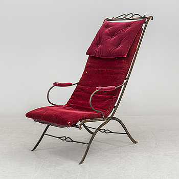 A late 19th century painted iron chair.