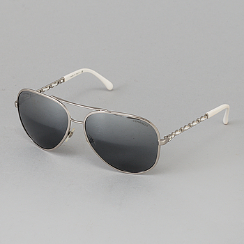 0d11f9018a A pair of sunglasses by Chanel.