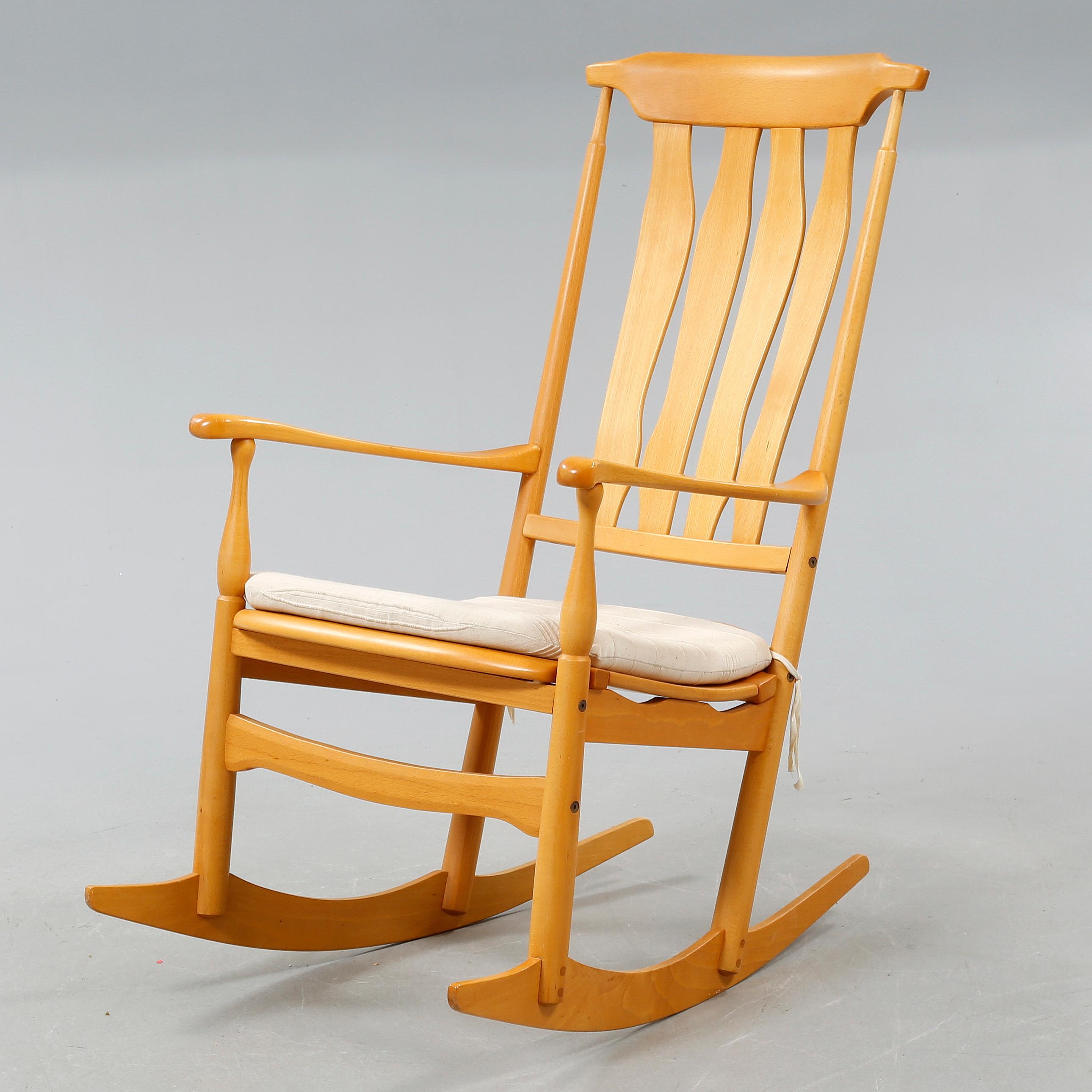 "A rockin chair named ""Vidar"" designed by Carl Malmsten made in"