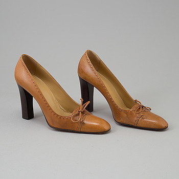 A pair of pumps by Gucci.
