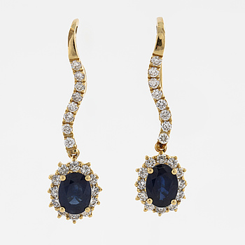 A pair of sapphire and brilliant cut diamond earrings.