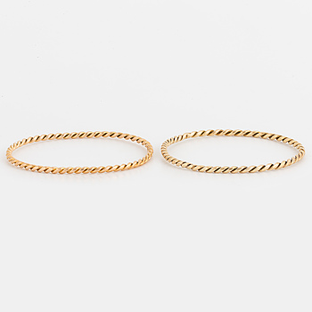 Two 14K gold bangles.