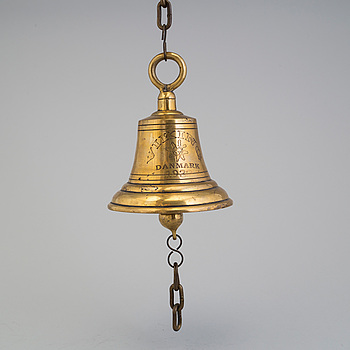 A brass ship bell, Denmark, dated 1932.