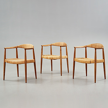 A set of three Hans J Wegner teak and rattan chairs, model JH 501, executed by Johannes Hansen, Denmark 1950-60's.