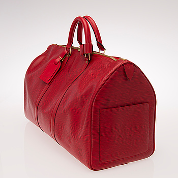 LOUIS VUITTON, A RED EPI LEATHER KEEPALL 50 TRAVEL BAG.