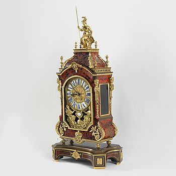 "A French gilt-metal mounted and brass-inlaid tortoiseshell ""Boulle-style"" bracket clock, late 19th century."