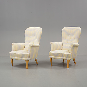 CARL MALMSTEN, A par of Carl Malmsten armchairs, second half of the 20th century.