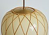 A pair of swedish vanilla coloured glass ceiling lights with fretted rattan, 1930-40's.