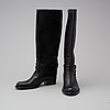 A pair of boots by  ralph lauren, in size 7,5b