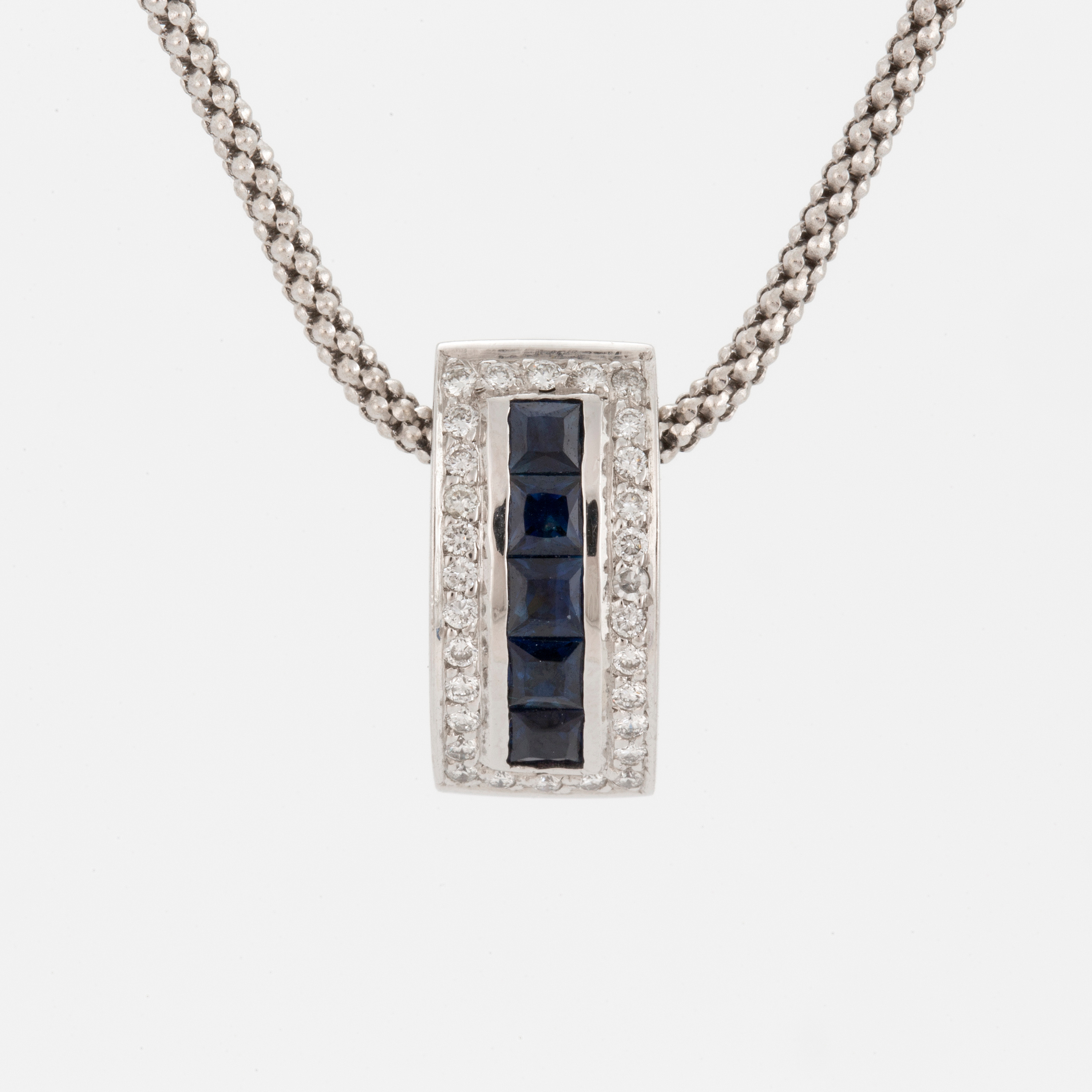 An 18k white gold chain and a pendant set with carr cut sapphires 10812389 bukobject audiocablefo light catalogue