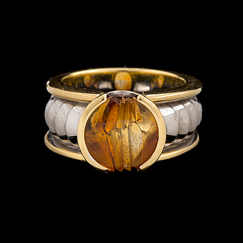 An 'On track' ring by Jan Jörgensen for Georg Jensen set with a fantasy cut citrine, ca 1980's.
