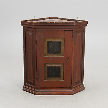 A hanging corner cabinet from the 19th century.
