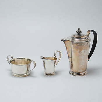 A silver coffee pot, sugar bowl and creamer by Thore Eldh for K&EC in Göteborg, 1949.