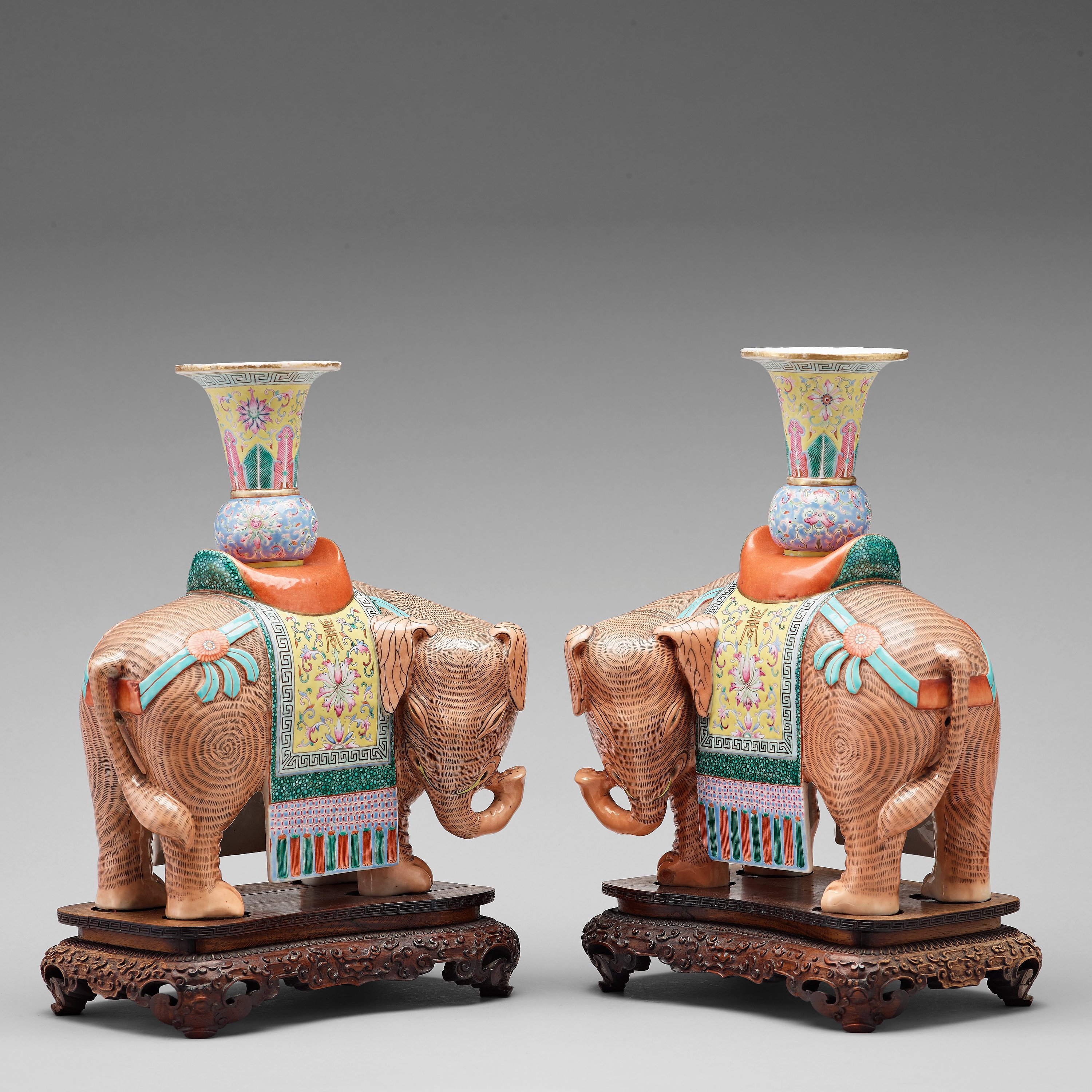 A pair of famille rose caparisoned elephants, Qing dynasty, Jiaqing