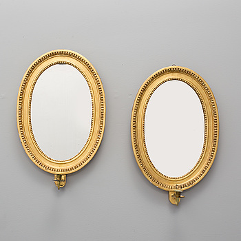 A pair of  one-light girandole mirrors, late 19th century.