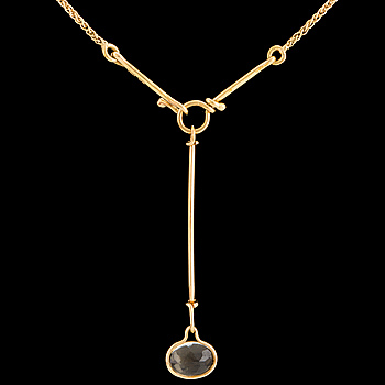 A 'Savannah' pendant set with a faceted citrine by Vivianna Torun Bülow Hübe for Georg Jensen, designed 2006.
