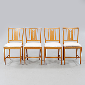 """CARL MALMSTEN, Four chairs designed by Carl Malmsten and named """"Ulfåsa""""."""
