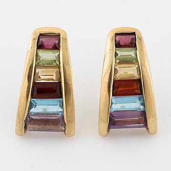A pair of multi colored gemstones.
