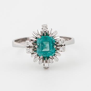 A emerald and single cut diamond ring.