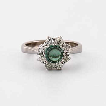A cabochon cut tourmaline and brilliant cut diamond ring.