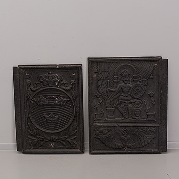 A SET OF TWO CAST IRON STOVE FRONTS, 19th century.