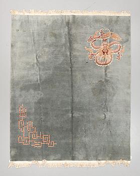A Tibitian / Chinese carpet, around 300 x 250 cm.
