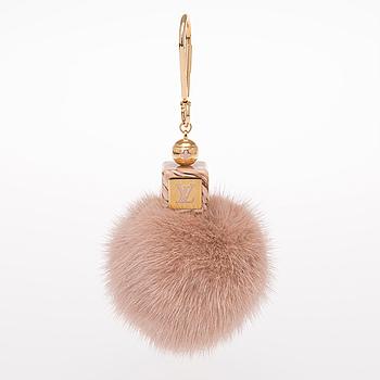 LOUIS VUITTON, A Louis Vuitton bag charm.