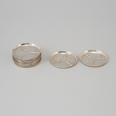 A set of 11 silver coasters from mexico.