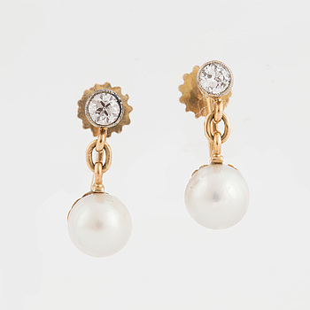 A pair of earrings set with cultured pearls and old-cut diamonds.